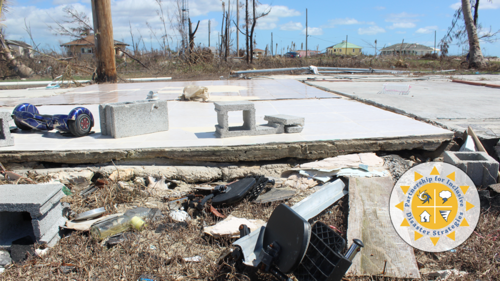 Aftermath of a hurricane with debris scattered around a bare concrete foundation.