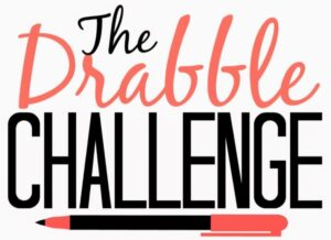 """Graphic: black and orange text reads, """"The Drabble Challenge"""". A black and orange pen sits below the text."""